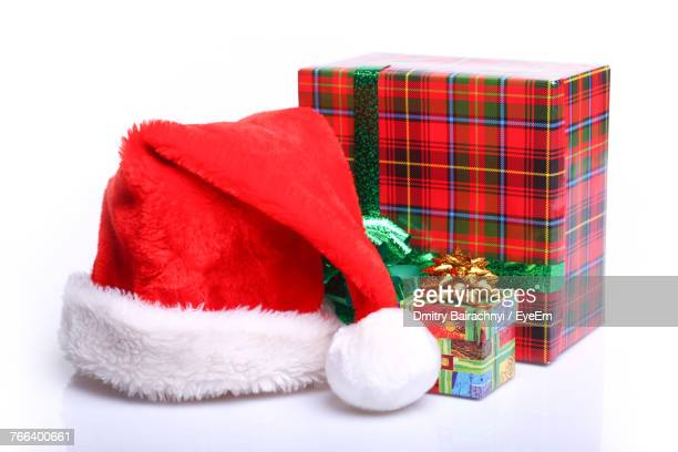 close-up of colorful gifts over white background - santa hat stock photos and pictures