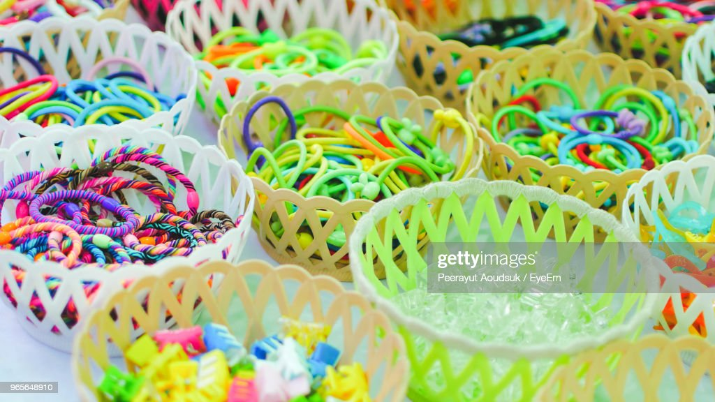 Closeup Of Colorful Hair Accessories In Baskets For Sale At Market