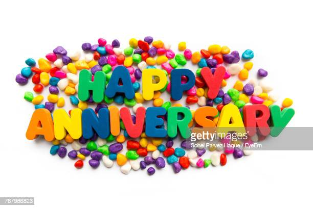 Close-Up Of Colorful Happy Anniversary Text Over White Background