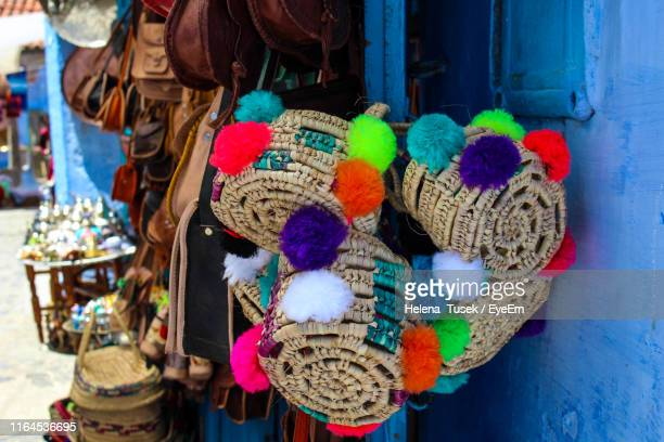 close-up of colorful hats for sale at market - helena price stock-fotos und bilder