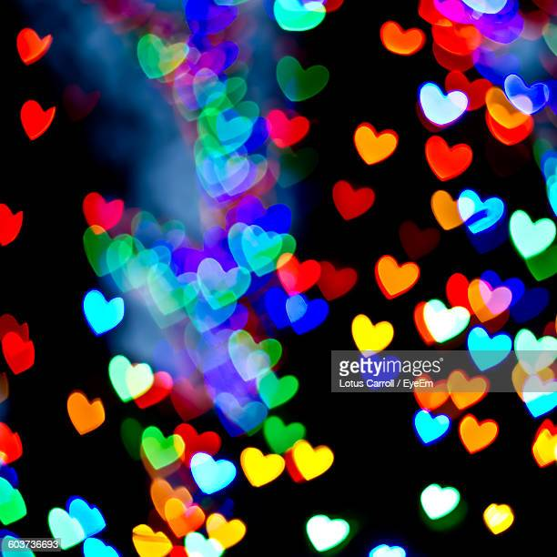 Close-Up Of Colorful Illuminated Heart Shapes Lights