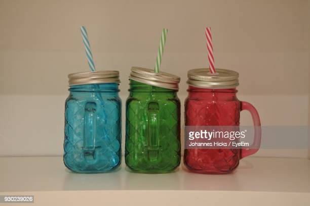 Close-Up Of Colorful Jars On Table