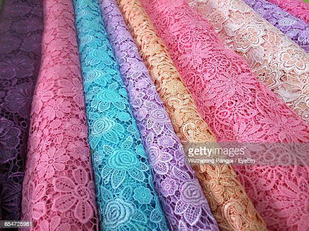 close-up of colorful lace fabrics - lace textile stock pictures, royalty-free photos & images
