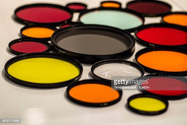 Close-Up Of Colorful Lens On Table