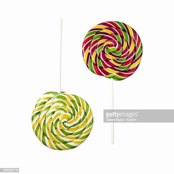 Close-Up Of Colorful Lollipops Against White Background