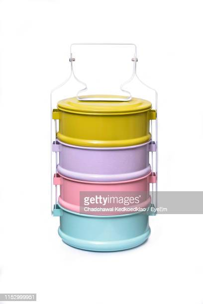 close-up of colorful lunch box against white background - tiffin box photos et images de collection