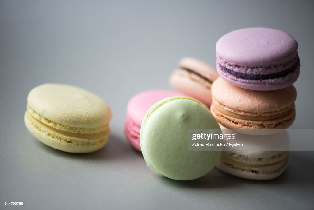 Close-Up Of Colorful Macaroon On Gray Background : Stock Photo