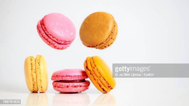 Close-Up Of Colorful Macaroons Against White Background