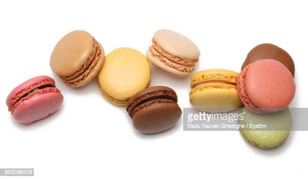close-up of colorful macaroons over white background - macarons stock photos and pictures