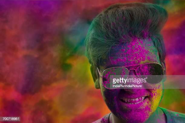 Close-Up Of Colorful Man Celebrating Holi