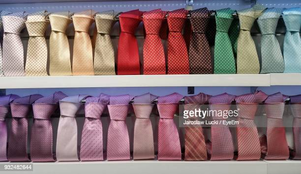 Close-Up Of Colorful Neckties Arranged On Shelves In Store