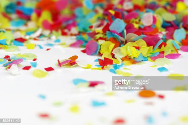 Close-Up of Colorful Paper Confetti on White Background With Copy Space