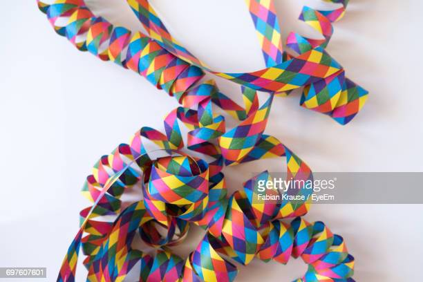 Close-Up Of Colorful Paper On White Background During Christmas