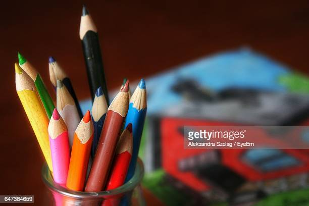 Close-Up Of Colorful Pencils In Desk Organizer On Table