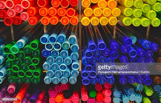 Close-Up Of Colorful Pens On Rack For Sale
