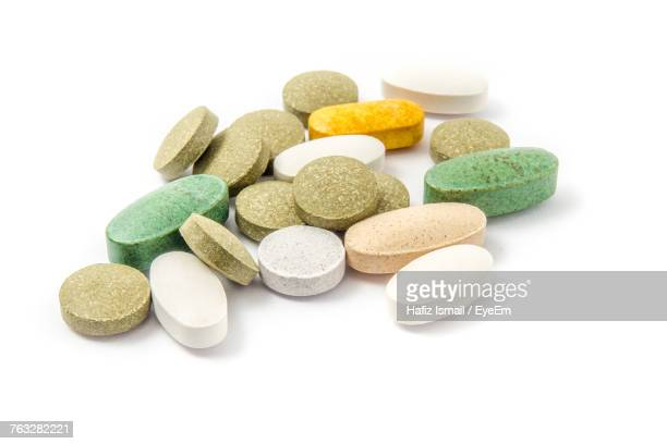 Close-Up Of Colorful Pills Over White Background