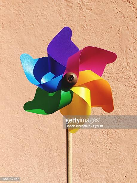 Close-Up Of Colorful Pinwheel Toy Against Wall