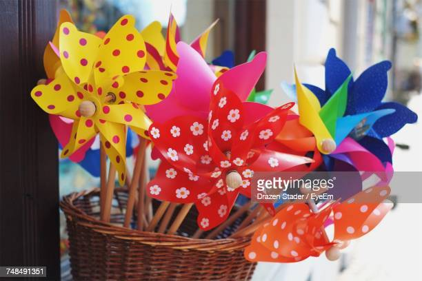 Close-Up Of Colorful Pinwheels In Wicker Basket At Shop