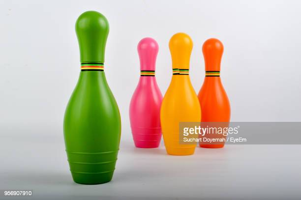 Close-Up Of Colorful Plastic Bowling Pins Against White Background