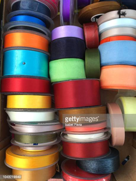 close-up of colorful ribbons for sale - ribbon sewing item stock pictures, royalty-free photos & images