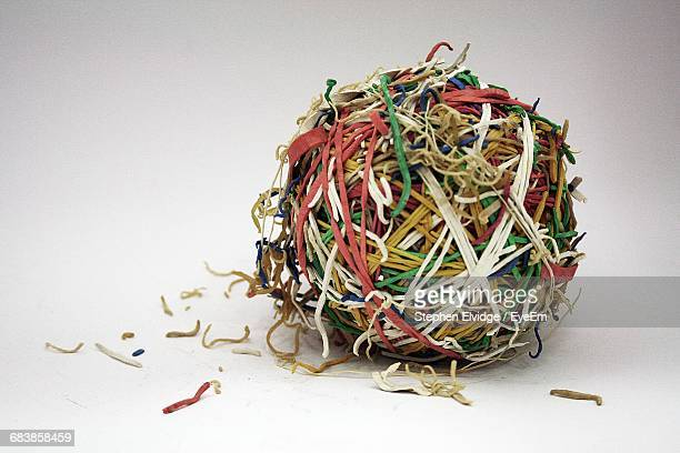 Close-Up Of Colorful Rubber Band Ball On White Background
