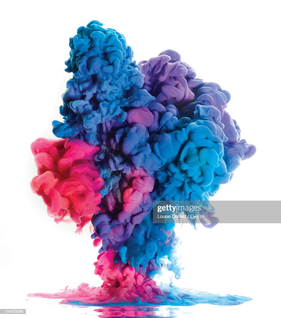 Close-Up Of Colorful Smoke Against White Background : Stock Photo