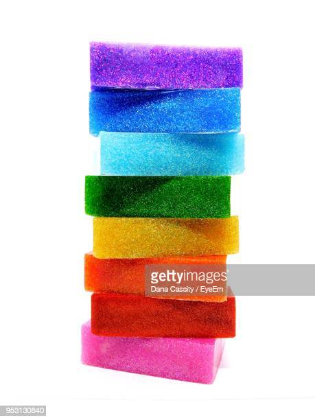 Close-Up Of Colorful Soaps Over White Background
