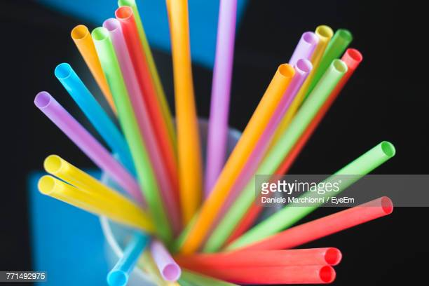 Close-Up Of Colorful Straws In Desk Organizer On Table