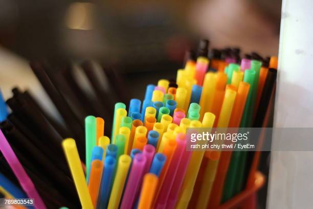 Close-Up Of Colorful Straws In Desk Organizer