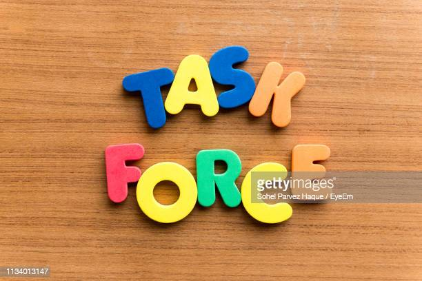 close-up of colorful text on table - task force stock pictures, royalty-free photos & images