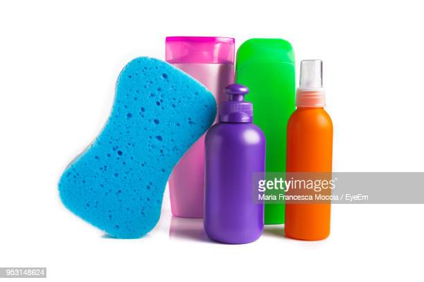 Close-Up Of Colorful Toiletries Over White Background