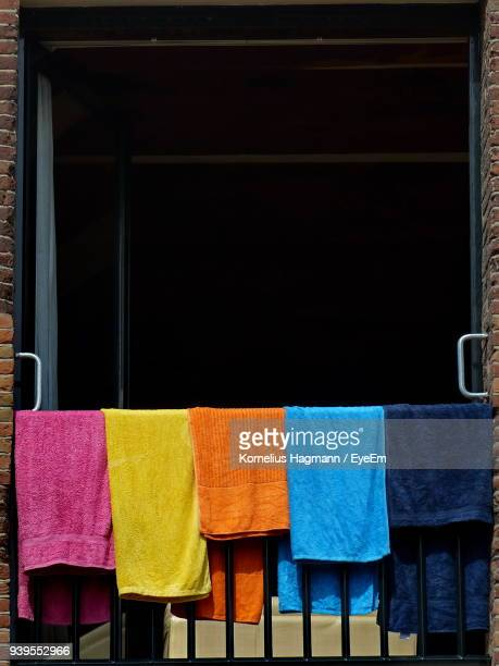 close-up of colorful towels drying on railing in balcony - drying stock pictures, royalty-free photos & images