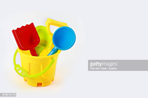 Close-Up Of Colorful Toys Over White Background
