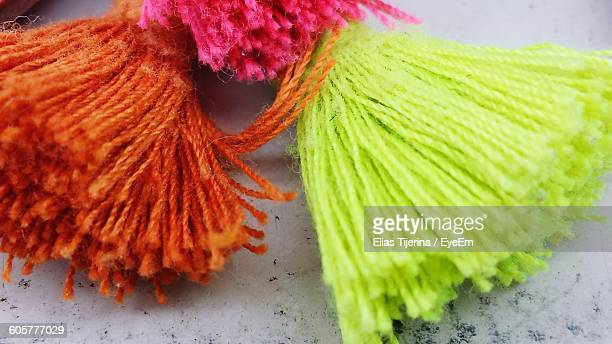 Close-Up Of Colorful Woolen Tassels