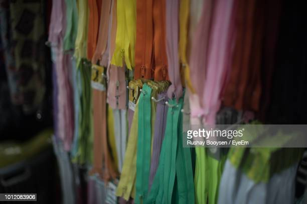 Close-Up Of Colorful Zippers For Sale In Market