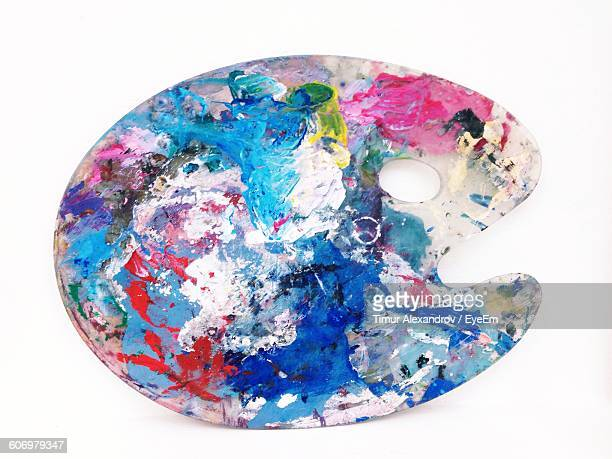 close-up of colors on palette against white background - art and craft equipment stock pictures, royalty-free photos & images