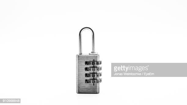 close-up of combination lock against white background - padlock stock photos and pictures