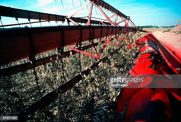 Close-up of combine harvesting soy beans in Maryland