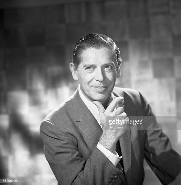 Close-up of comedian Milton Berle with his chin in his hand.