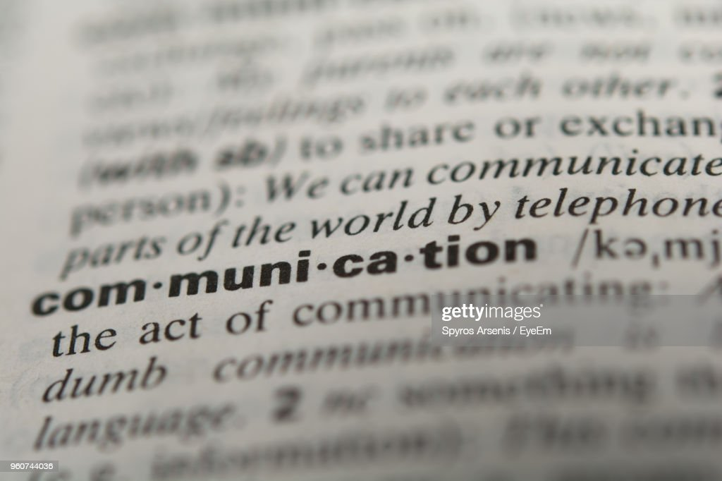 Close-Up Of Communication Text In Dictionary : Stock Photo