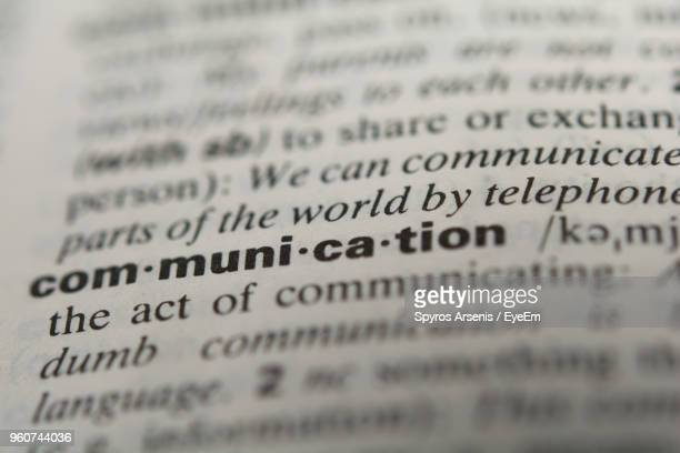 close-up of communication text in dictionary - dictionary stock pictures, royalty-free photos & images