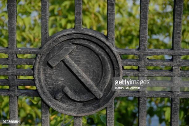 close-up of communist symbol on fence - bandiera comunista foto e immagini stock