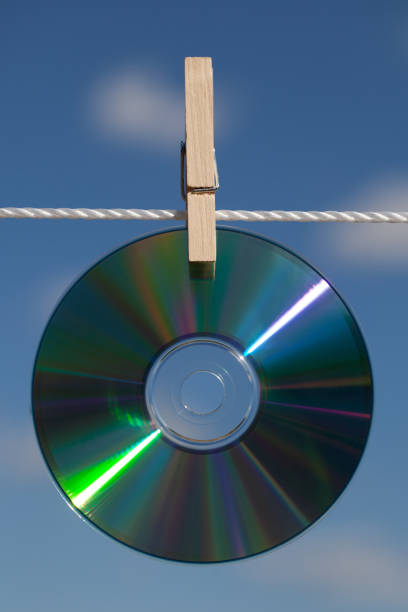 Close-up of compact disc against sky