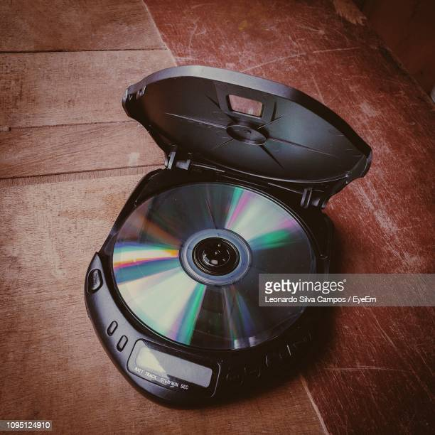 close-up of compact disc on musical equipment - compact disc stock pictures, royalty-free photos & images