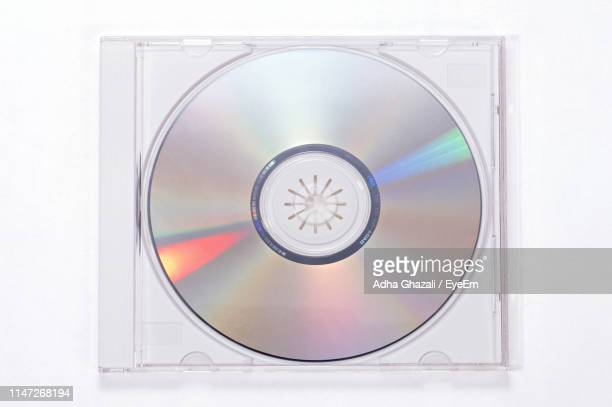 close-up of compact disc over white background - compact disc stock pictures, royalty-free photos & images