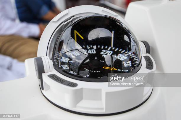 close-up of compass in sailboat - navigational equipment stock pictures, royalty-free photos & images