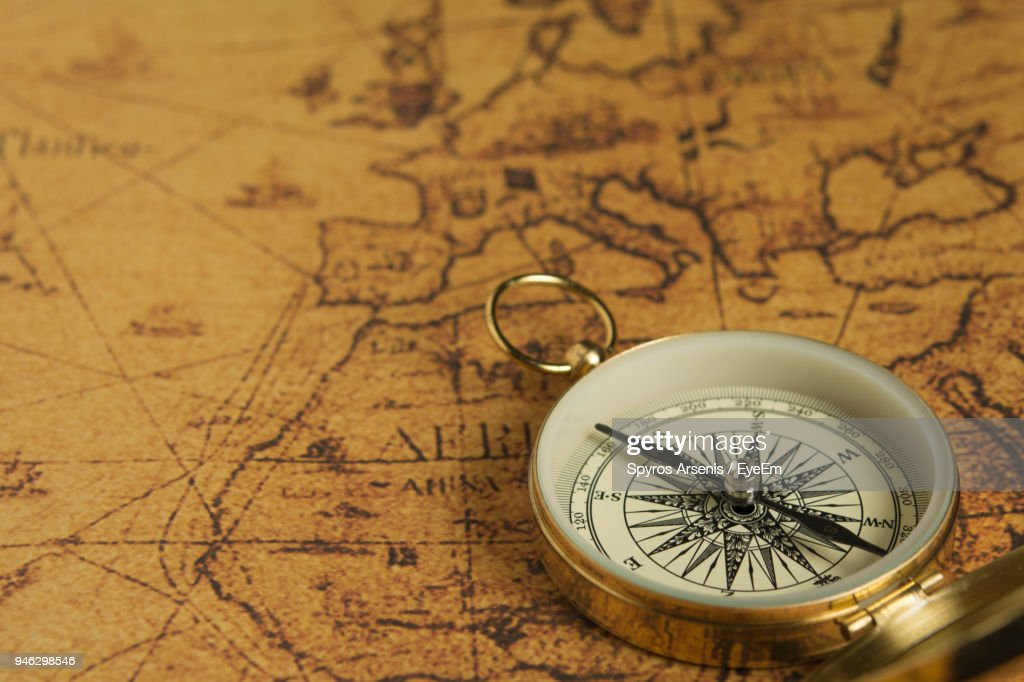 Close-Up Of Compass On Map : Foto de stock