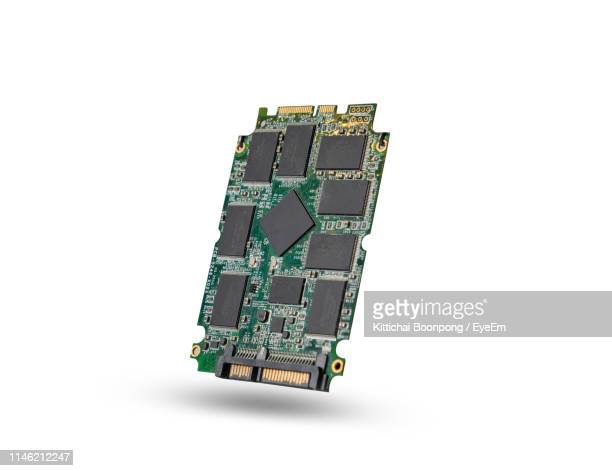 close-up of computer chip against white background - computer chip stock pictures, royalty-free photos & images