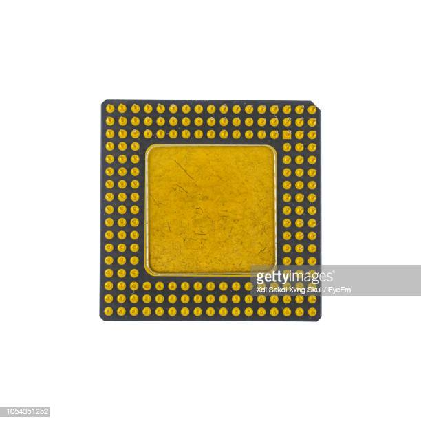 close-up of computer chip over white background - computer chip stock pictures, royalty-free photos & images