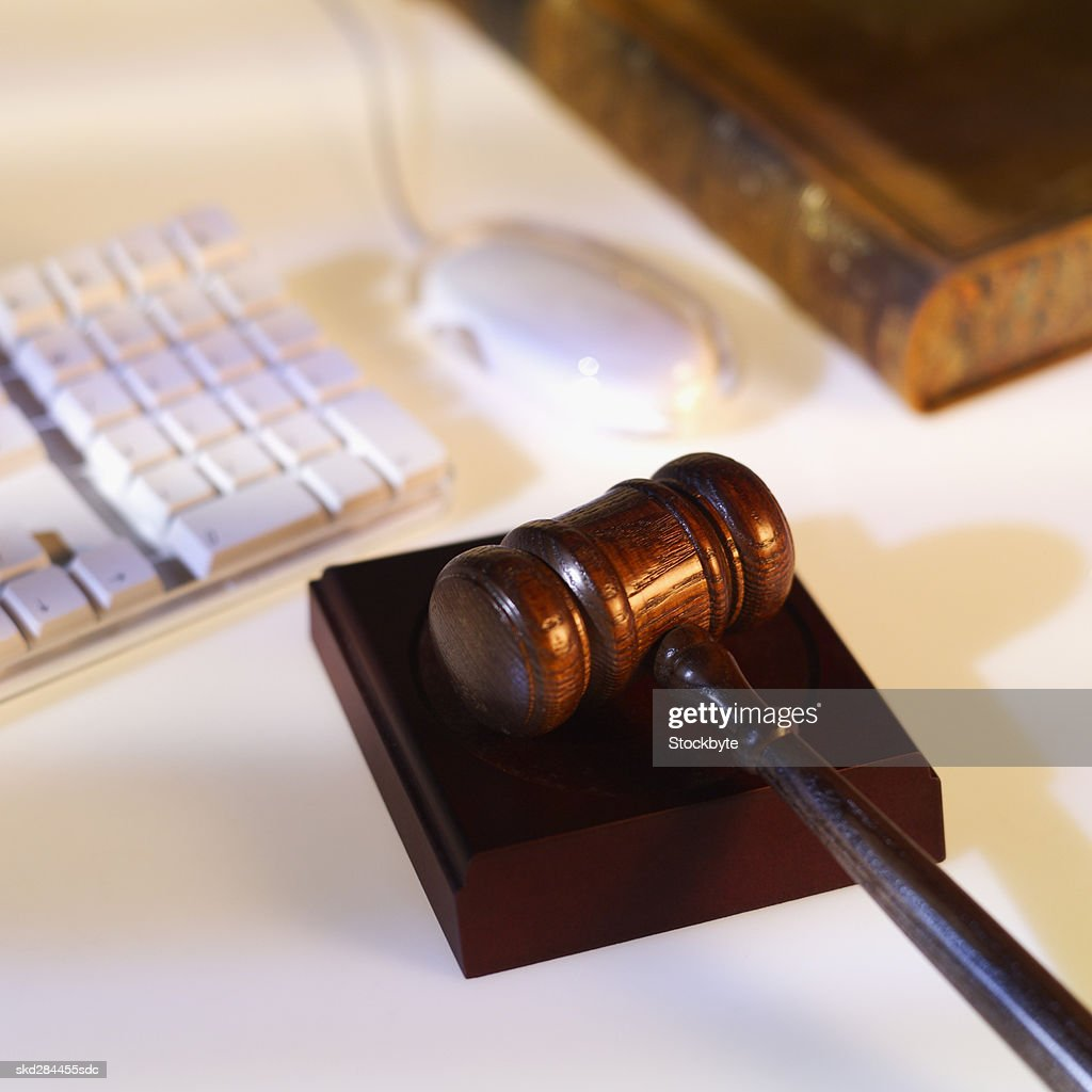 Close-up of computer keyboard and mouse with textbook and gavel beside it : Stock Photo